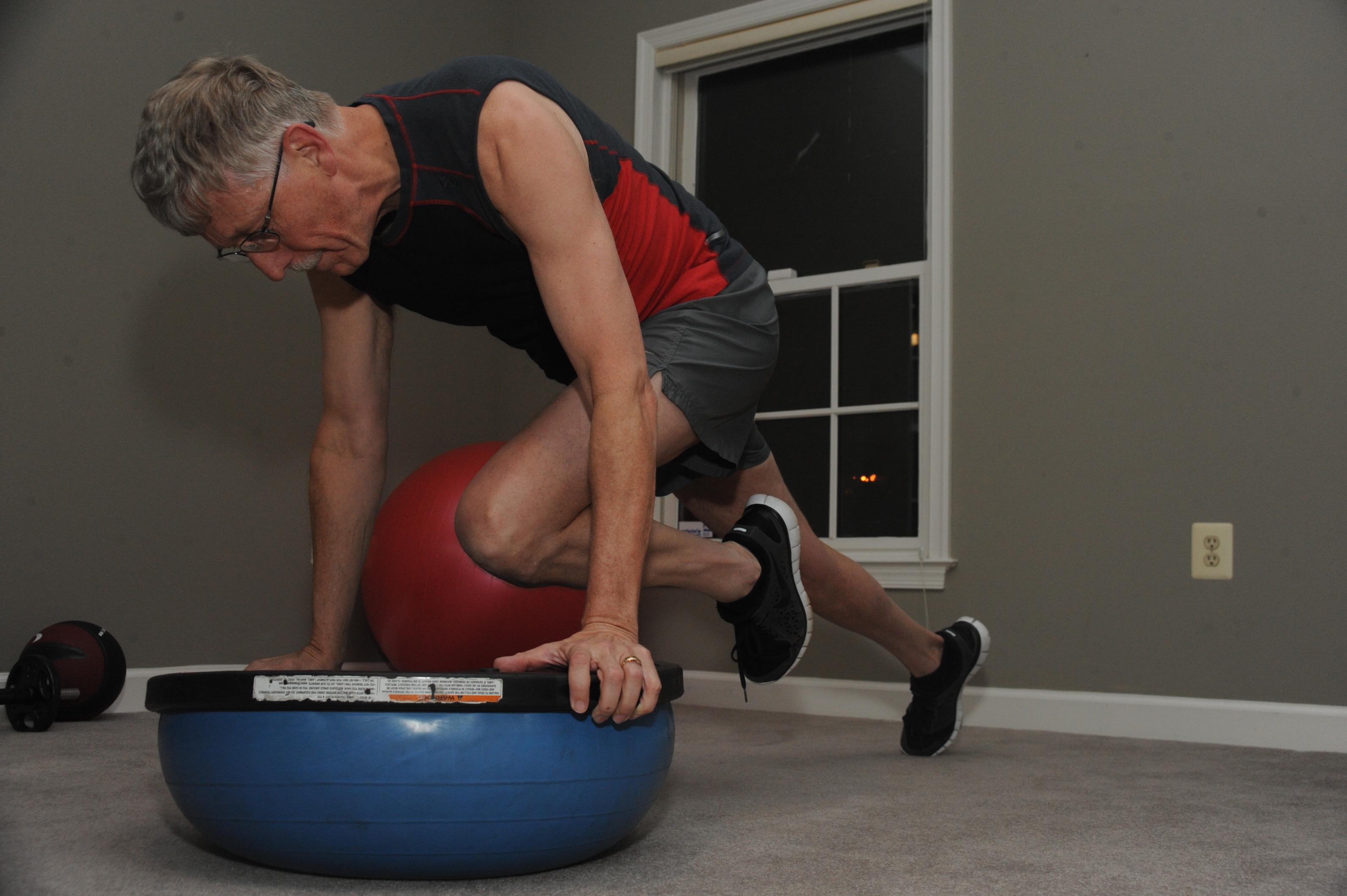Man exercising with a BOSU ball
