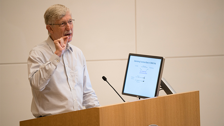 Dr. Collins speaking at Cornell