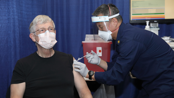 Man receiving vaccine shot